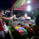 SIDEWALK FAVORITE. A foreign tourist buys a glass of shake from a locally grown fruit as she tries to cool off during a humid afternoon at Roxas Night Market in Davao City on Saturday. LEAN DAVAL JR.