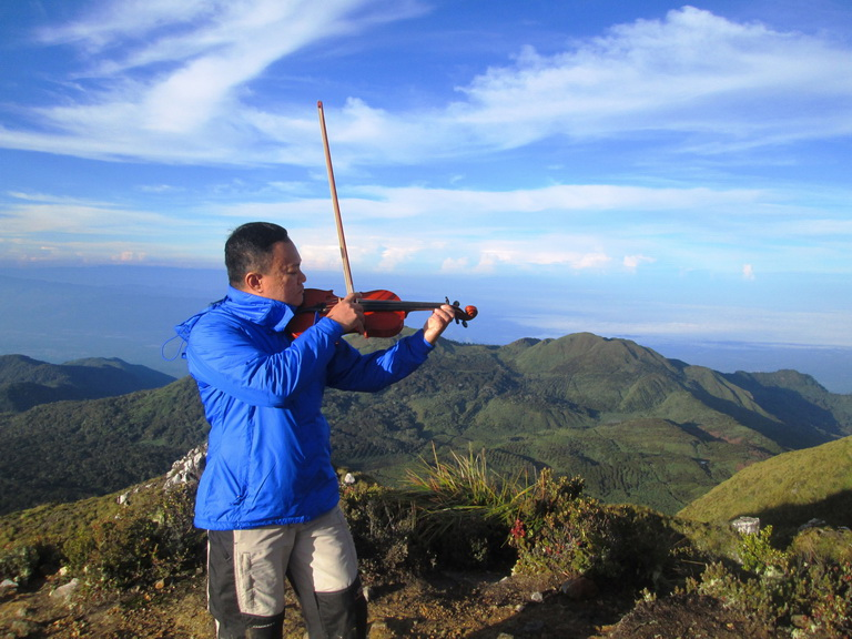 Making history by being the first person to play the violin at the summit of Mt. Apo.