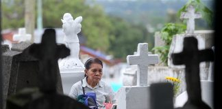 BEYOND FORGETTING. Sadness is written on the face of an elderly woman as she offers a prayer to the tomb of a departed loved one at the Roman Catholic cemetery in Madapo Hills, Davao City on All Saints' Day. Thousands of Dabawenyos have visited their departed relatives in the city's cemeteries during the observance of Undas. LEAN DAVAL JR.