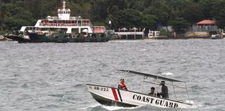 Rough Waters. Philippine Coast Guard personnel monitor the Davao Gulf amid rough waters brought by Tropical Storm 'Vinta' on Thursday, December 21. The PCG has cancelled the trips of passenger vessels plying Davao City-Samal and Talicud Island routes, except for the ferry boats transporting motorists and passengers from Sasa to Babak in Samal. Mindanews Photo