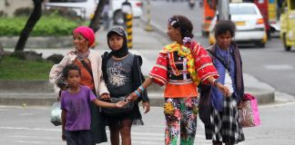 SEASON SIGHT. A group of Indigenous People from the hinterlands of Davao City roams around Davao City's downtown area to solicit Christmas gifts from the establishments and residents on Monday. LEAN DAVAL JR.