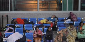 IN THE INTERIM. Passengers take a rest on the benches while waiting for their early flight at the Davao International Airport in Davao City over the weekend. LEAN DAVAL JR