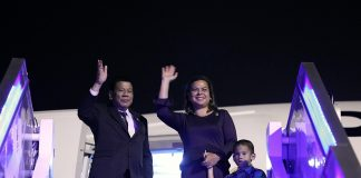 President Rodrigo Duterte and Davao City Mayor Sara Duterte-Carpio wave farewell to the send-off party as they prepare to board the Philippine Airlines Charter Flight PR001 at the Qionghai Boao International Airport on Tuesday night following a successful participation to the Boao Forum for Asia (BFA) Annual Conference 2018. Also in the photo is the President's grandson Mateo. PRESIDENTIAL PHOTO