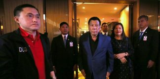 President Rodrigo Duterte is accompanied by his partner Honeylet upon his arrival at the Harbourview Hong Kong for a dinner with some friends from Hong Kong on Wednesday. Also in the photo is Special Assistant to the President Christopher Lawrence Go. PRESIDENTIAL PHOTO