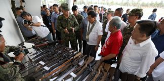 President Rodrigo Duterte leads the inspection of the firearms seized from the New People's Army on the sidelines of his attendance to the ceremonial distribution of the Certificates of Land Ownership Award (CLOAs) to the Agrarian Reform Beneficiaries at the Sultan Kudarat Sports and Cultural Center in the Municipality of Isulan, Sultan Kudarat on Monday. Joining the President are 6th Infantry Division Commander Major General Arnel dela Vega, Sultan Kudarat First District Representative Suharto Mangudadatu and Special Assistant to the President Christopher Lawrence Go. PRESIDENTIAL PHOTO