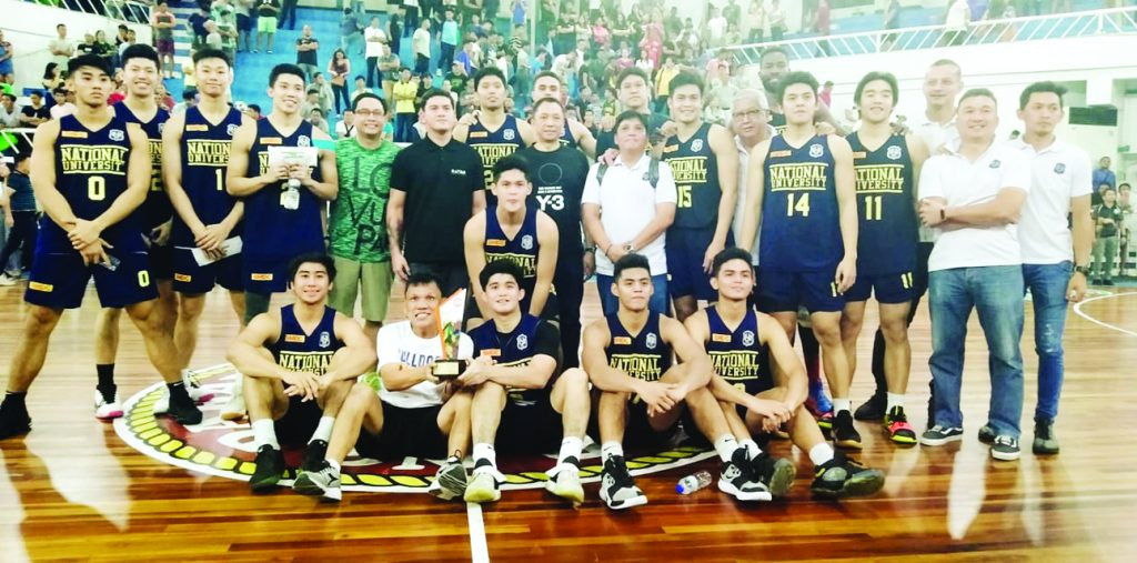 The National University Bulldogs take a championship pose with Vice Mayor Baste Duterte and Samahang Basketball ng Pilipinas (SBP) 11 regional director and Presidential Adviser for Sports Glenn Escandor.