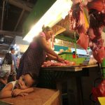 A lady meat vendor prepares pork meat for a customer at Agdao Public Market's meat section on Tuesday. According to local hog raisers, pork meat consumption has gone down amidst the African Swine Fever (ASF) scare. Lean Daval Jr